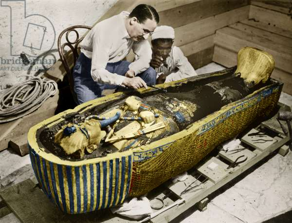 Howard Carter (1873-1939) english egyptologist near golden sarcophagus of Tutankhamon (mummy) in Egypt in 1922 (photo Harry Burton) colourized document