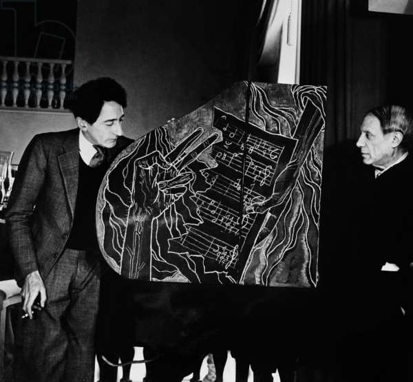 Jean Cocteau and Pablo Picasso with piano created by Cocteau at Anchorenas, 1943