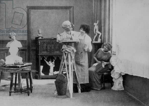 Sarah Bernhardt (1844-1923) making the bust of Edmond Rostand c. 1900