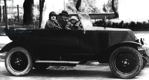 F Scott Fitzgerald with his wife, Zelda and daughter, Scottie on the road, in France (b/w photo)