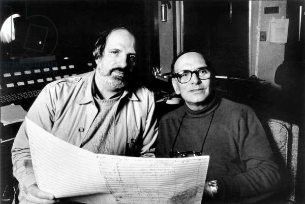 THE UNTOUCHABLES, from left: director Brian De Palma, composer Ennio Morricone, 1987.