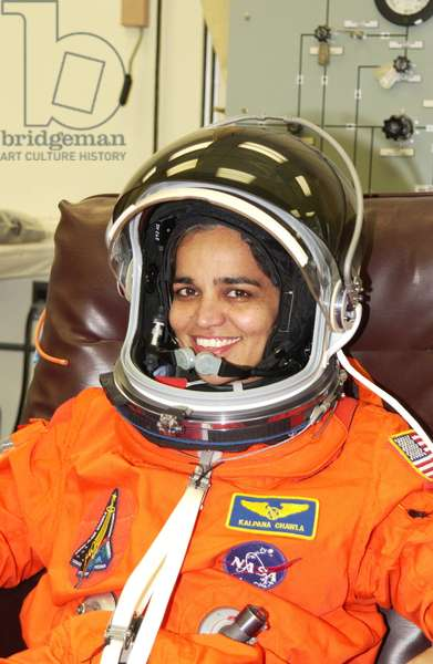 Mission Specialist Kalpana Chawla is helped suiting up for Terminal Countdown Demonstration Test activities, which include a simulated launch countdown at the pad january 2003