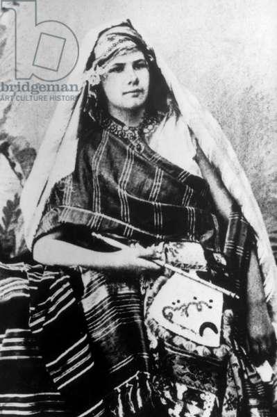 Isabelle Eberhardt (1877-1904) swiss explorer who lived in Algeria in 1897-1904 here wearing arabian costume c. 1900