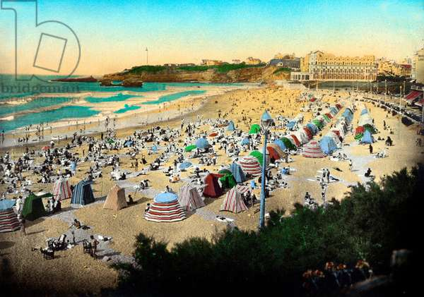 Biarritz (France): la Grande Plage, the palace of Empress Eugenie converted into the Hotel du Palais in 1893, the lighthouse on the pointe Saint Martin. Postcard, c 1920.