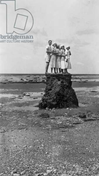 Holidays at the sea: family on a rock, c. 1925