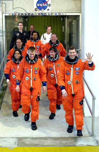 """KENNEDY SPACE CENTER, FLA. The STS-107 crew exits the Operations and Checkout Building for a ride to Launch Pad 39A and a simulated launch countdown. From left are Payload Specialist Ilan Ramon, Mission Specialist Kalpana Chawla, Payload Commander Michael Anderson, Mission Specialist David Brown, Pilot William """"Willie"""" McCool, Mission Specialist Laurel Clark and Commander Rick Husband. The countdown is part of Terminal Countdown Demonstration Test activities january 2003"""