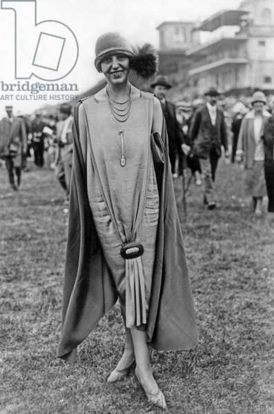 Elegant woman at equestrian race in Chantilly (France) 1925