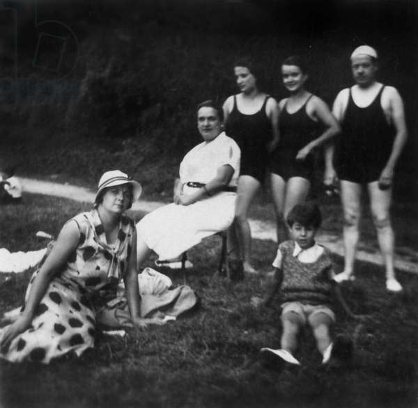 Day in the country: members of a family near a river (see the bathers in the background) c. 1925