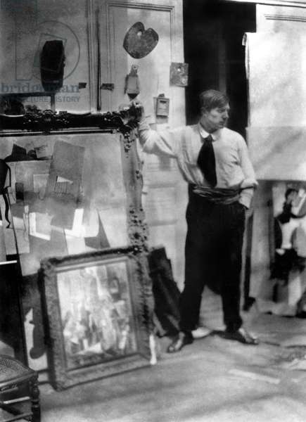 Spanish painter Pablo Picasso (1881-1973) in the workshop he occupied from 1914 to 1916 in Paris