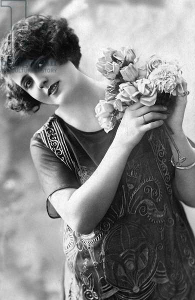 Romantic young woman with bunch of flowers, Postcard, c. 1920
