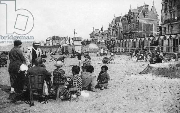 Group of people (mothers and children) on beach of Cabourg in Normandy, France, c. 1920