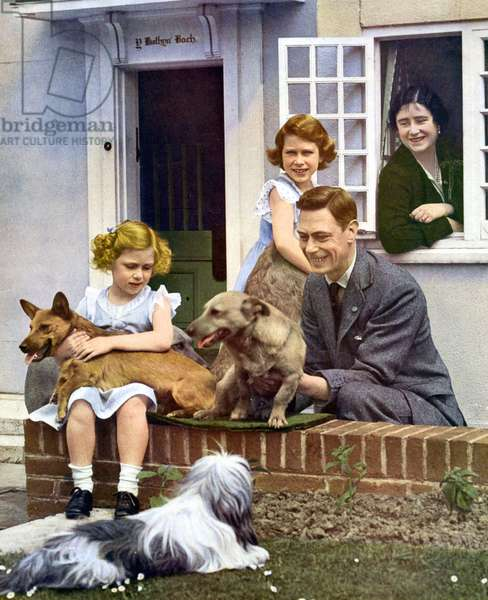 The Royal Family at Y Bwthyn Bach, Windsor, 1936. King George VI with his daughters and their pet dogs outside Y Bwthyn Bach (The Little House), the gift of the Welsh people to Princess Elizabeth (standing by the window). Princess Margaret is seated on the wall with a dog on her lap and Queen Elizabeth looks on from inside the cottage