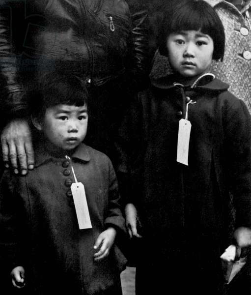Two Japanese American children in Hayward await relocation. May 8th 1942 (b/w photo)