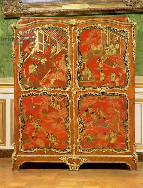 Armoire with four Chinoiserie red lacquer panels embellished with gilt mounts, 18th century