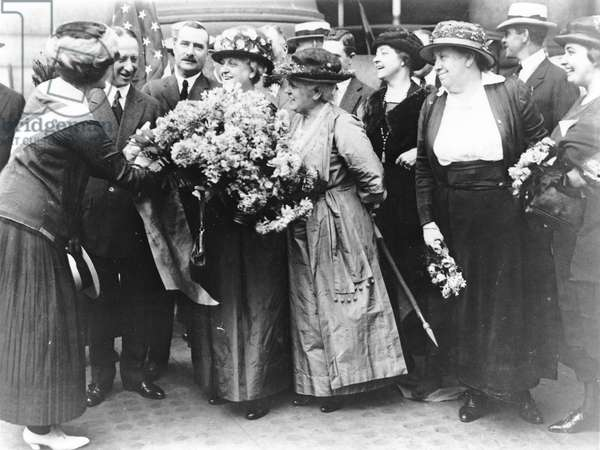 Suffragist Carrie Chapman Catt is congratulated in New York City after the 19th Amendment was ratified; August 27, 1920 (b/w photo)
