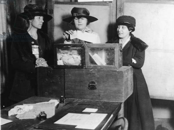 Three New York City women vote for the first time in a presidential election, November 2, 1920 (b/w photo)