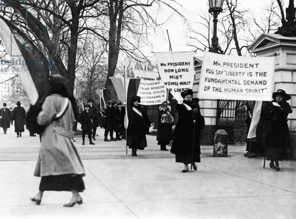 Picket line outside the White House demands Votes for Women despite frigid weather, 1917 (b/w photo)
