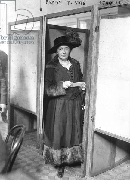 New Yorker Mary V. Lally ready to cast her vote in a voting booth, November 2, 1920 (b/w photo)