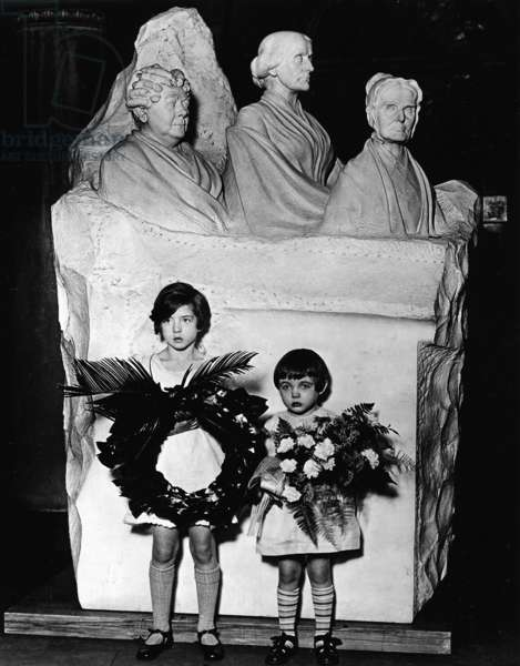 Descendants hold flowers before the Woman Suffrage Monument in the U.S. Capitol, 3rd January 1930 (b/w photo)