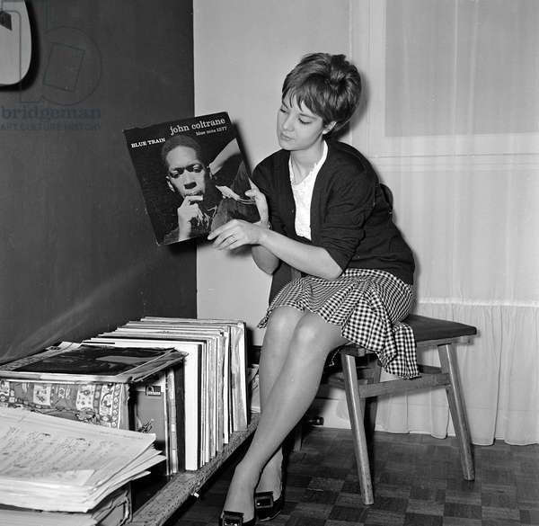 Singer Sylvie Vartan (Nee in 1944 in Bulgaria) with a vinyl record by John Coltrane in the early 1960s.