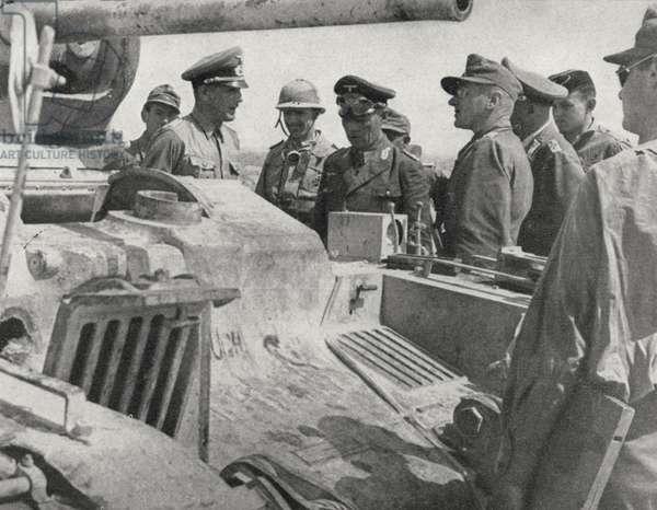 Colonel General Rommel examines a British tank captured near Tobruk, Libya, June 1942 (b/w photo)