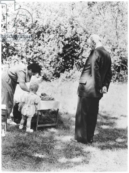 De Gaulle family picnic at the Dhuits springs, near Colombey-les-Deux-Eglises, General Charles de Gaulle (1890-1970) Yvonne de Gaulle (1900-70) and their grandson Yves de Gaulle, 1954 (b/w photo)