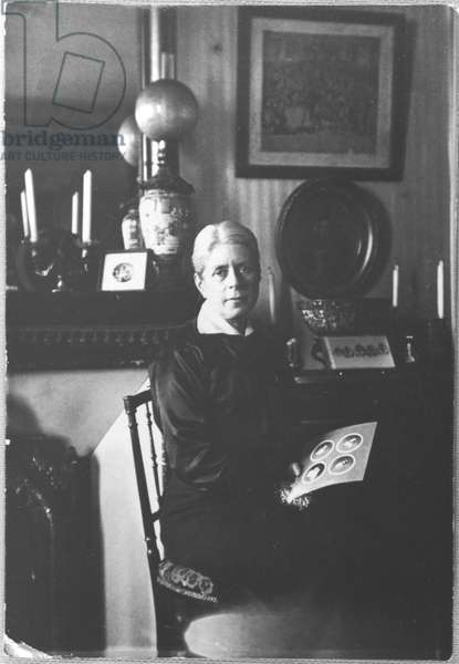 Portrait of Jeanne Maillot (1860-1940) mother of Charles de Gaulle, holding a photograph of her four sons, c.1920 (b/w photo)