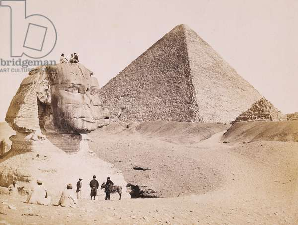 Egyptian guides with European tourists at the Sphinx, 1867 (b/w photo)