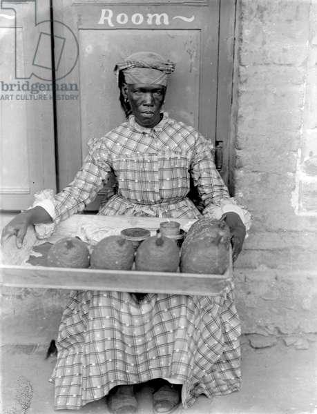 Woman selling breadfruit, Trinidad and Tobago, 1899-1901 (b/w photo)
