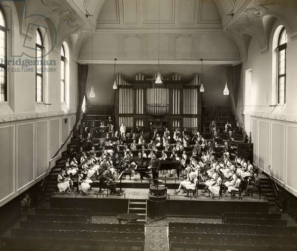 Henry Wood (1869-1944) conducting the Royal Academy of Music Students' Orchestra, June 1930. Duke's Hall