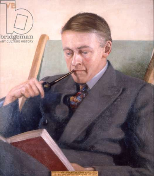 ARNOLD Bax seated with