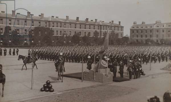 The Royal Marine Artillery march past their Colonel in Chief, HRH Prince George, the Prince of Wales at their barracks at Eastney, 1904 (b/w photo)