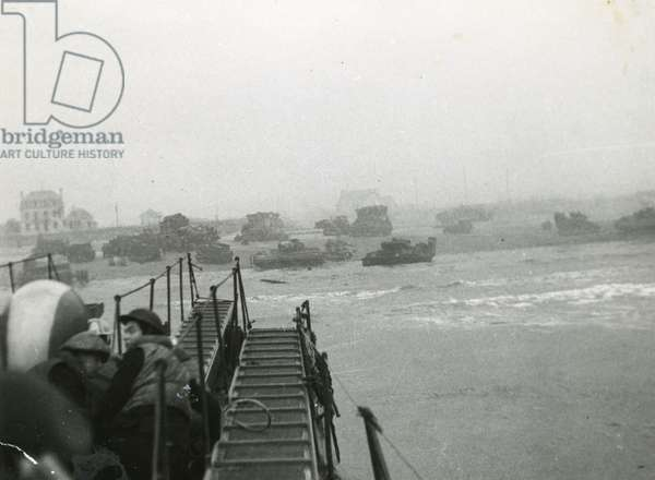 Marines landing at Sword Beach aboard a D.D. (Duplex Drive) tank, Normandy, France, 6 June 1944 (b/w photo)
