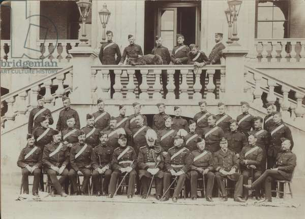 Royal Marine Artillery Officers seated in front of the Officers' Mess at the Royal Marine Artillery Barracks, Eastney, 1907 (b/w photo)