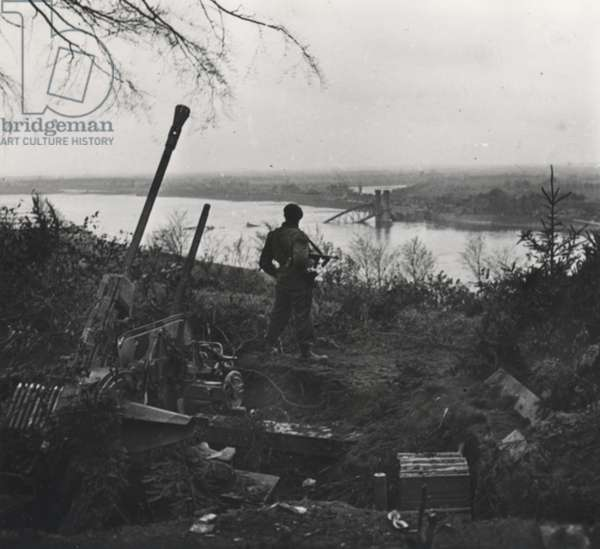 Marine Doyle of 45 (RM) Commando standing on high ground at Lauenburg, Schleswig-Holstein, Germany just after its capture following Operation Enterprise, 1945 (b/w photo)