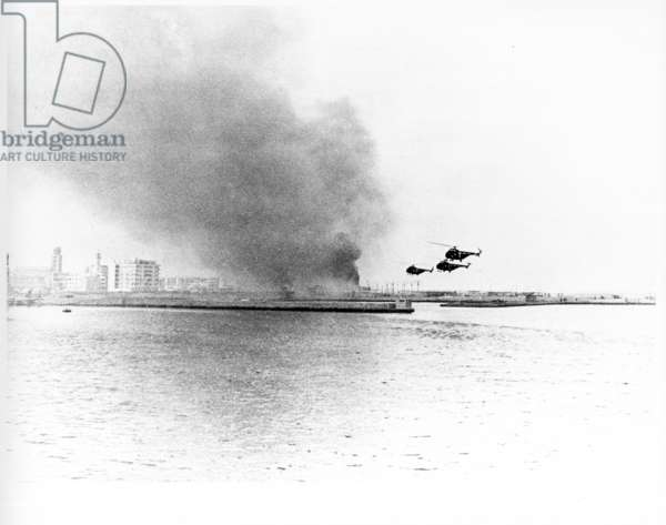 Helicopters over breakwater, Suez operation, 1956 (b/w photo)