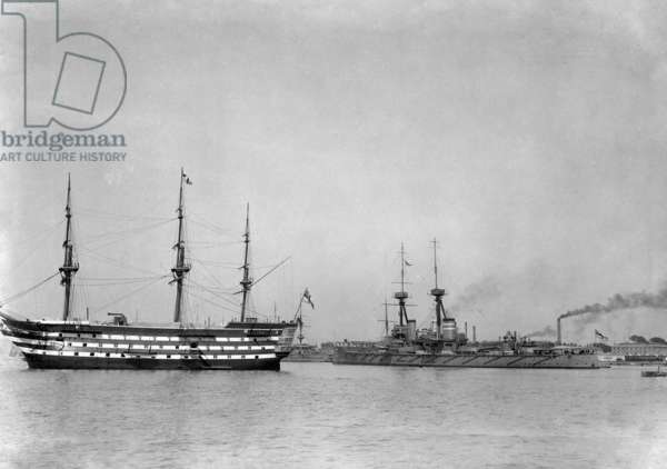 HMS St Vincent with HMS Victory in Portsmouth Harbour, c.1910 (b/w photo)