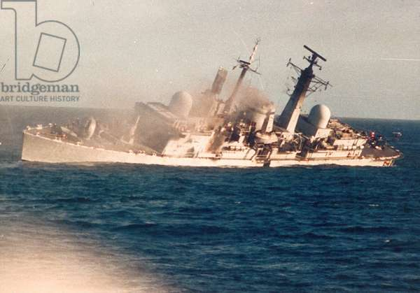 HMS Coventry hit by bombs and capsizing, 25 May 1982 (photo)