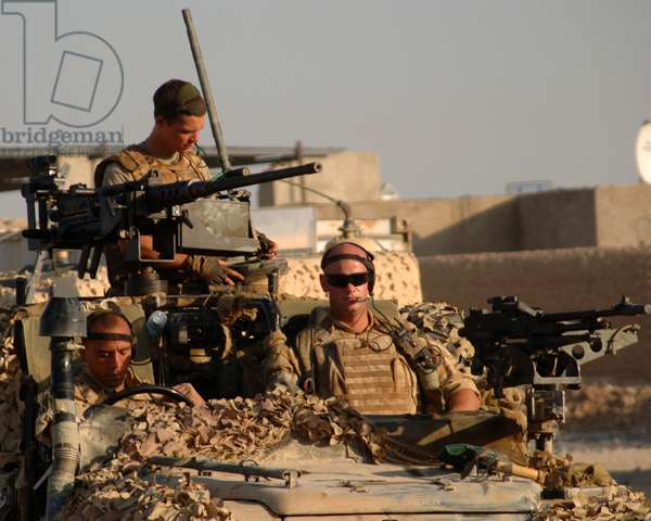 Army corporal Thompson (r), marine Beagles (driving) and unidentified marine in a WMIK, Operation Slate, Helmand Province, Afghanistan, 3 Nov 2006 (photo)