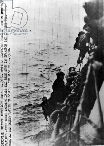 British destroyer Beagle rescues American sailors after their landing craft had sunk, 9th June, 1944 (b/w photo)