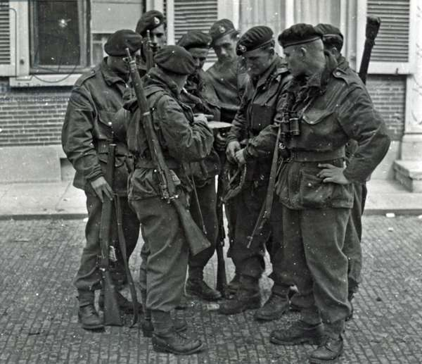 A Royal Marines NCO briefing his men before crossing the River Maas, Netherlands, March 1945 (b/w photo)