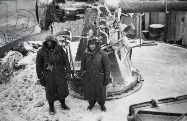 Iced up AA gun on board the cruiser HMS Jamaica (launched 1940) whilst sailing through Arctic waters, c.1943 (b/w photo)