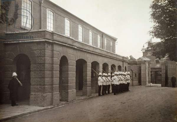 The Guard formed up outside the Guard Room at the Royal Marine Artillery Barracks, Eastney, 1904 (b/w photo)