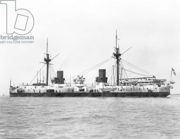 View of the ironclad battleship HMS Inflexible (launched 1876) pictured after conversion to military rig in 1885 (b/w photo)