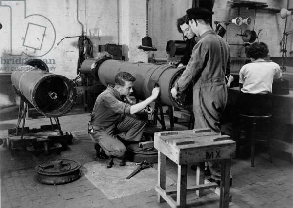 Royal Navy and Womens Royal Navy Service (WRNS) personnel in a mine workshop at the shore establishment HMS Vernon, Portsmouth, c.1941 (b/w photo)