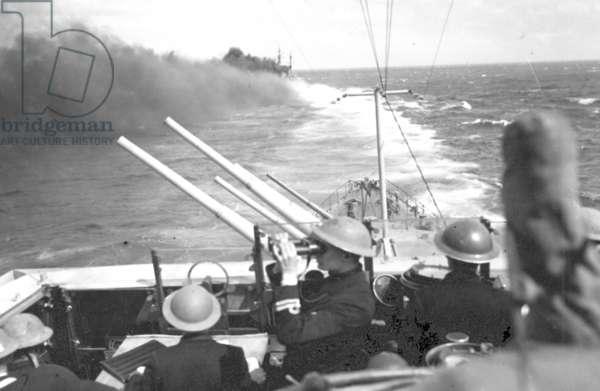HMS Cleopatra laying a Smoke Screen, c.1941 (b/w photo)