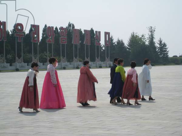 North Korean women in traditional dress walking towards Kumsusan Palace of the Sun in Pyongyang, 2008 (photo)
