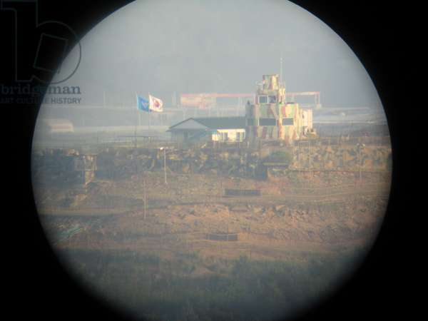 South Korean border post in the Korean Demilitarised Zone, as seen from a viewing telescope in North Korea, 2008 (photo)
