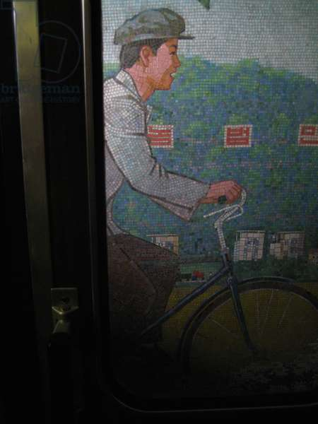 Mosaic of worker on bicycle in the Pyongyang Metro, 2008 (photo)