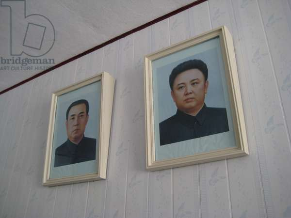 Framed propaganda portraits depicting the North Korean leaders Kim Il-sung and Kim Jong-il, 2008 (photo)